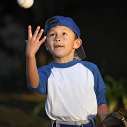 Little Boy Catching Baseball